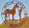 Cowgirl and horse barn sign