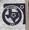 Sign Bracket and Round Sign Circled Texas Address